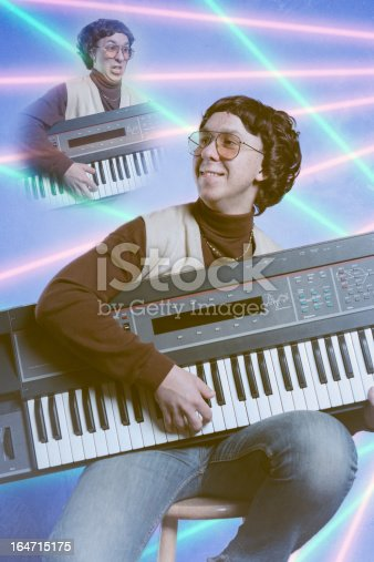 A late 1980's - early 1990's emulation of a bad school portrait, complete with tacky pink and cyan lasers in the blue background of a young nerd in a turtleneck with a sweater vest and gold chain.  He holds onto a vintage looking keyboard synthesizer.  Low contrast and bad posing; glamour shots at their best/worst!