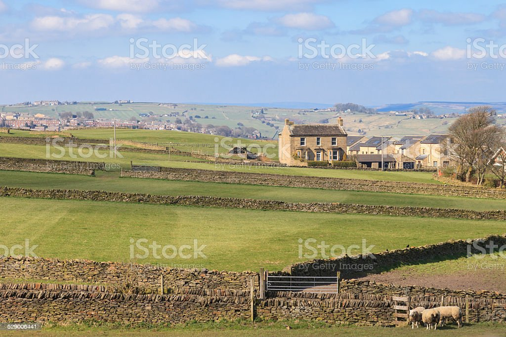 Early spring landscape with farms stock photo