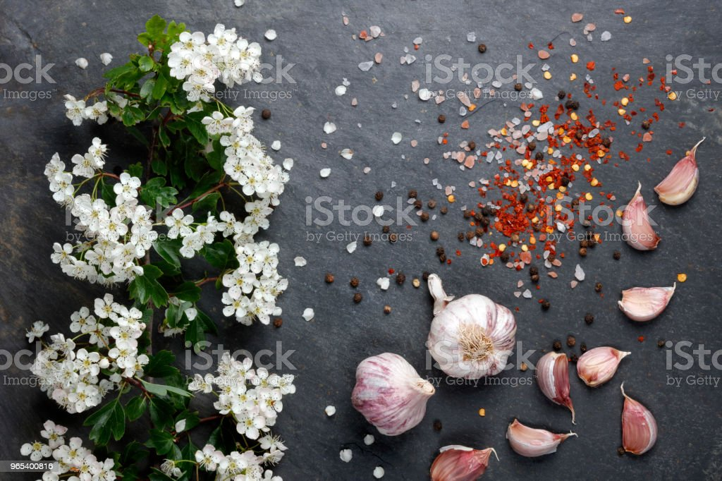 Early summer white  flower blossoms with pink garlic and Himalayan rock sal royalty-free stock photo