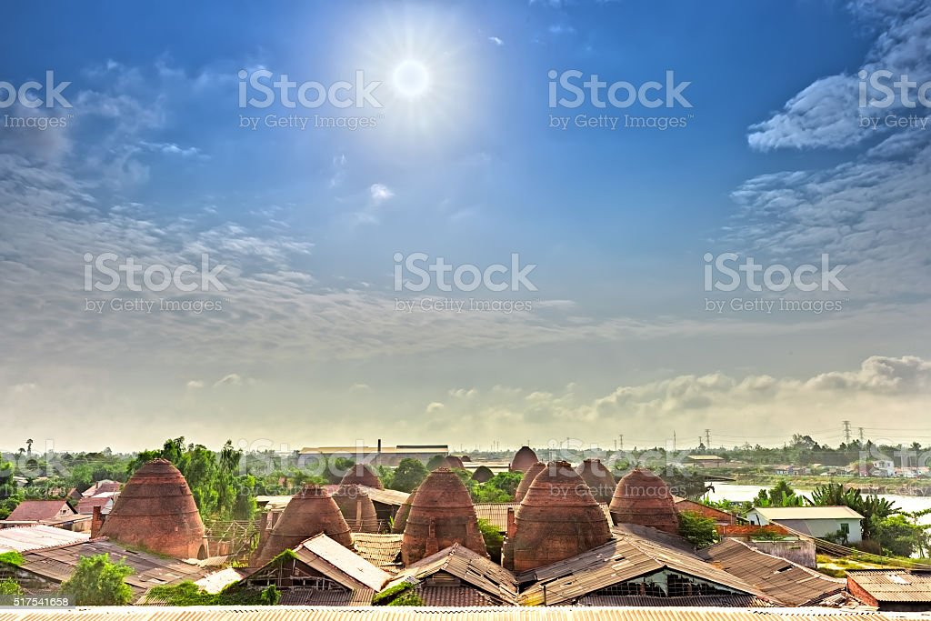 Early sun on roof brick kilns in countryside stock photo