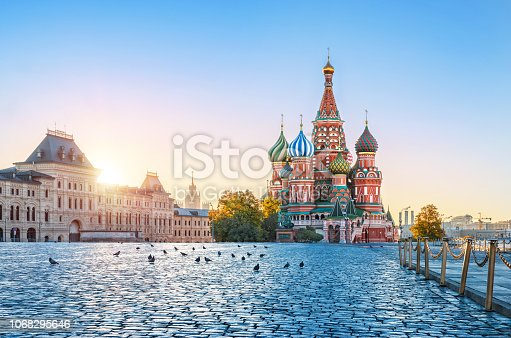 St. Basil's Cathedral on Red Square in the Moscow Kremlin on an early autumn sunny morning and pigeons