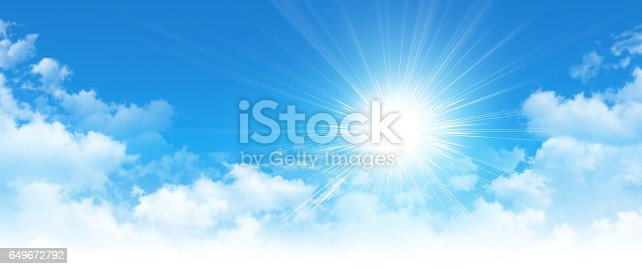 istock Early sunshine in a cloudy blue sky 649672792
