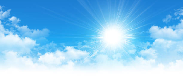 Early sunshine in a cloudy blue sky stock photo
