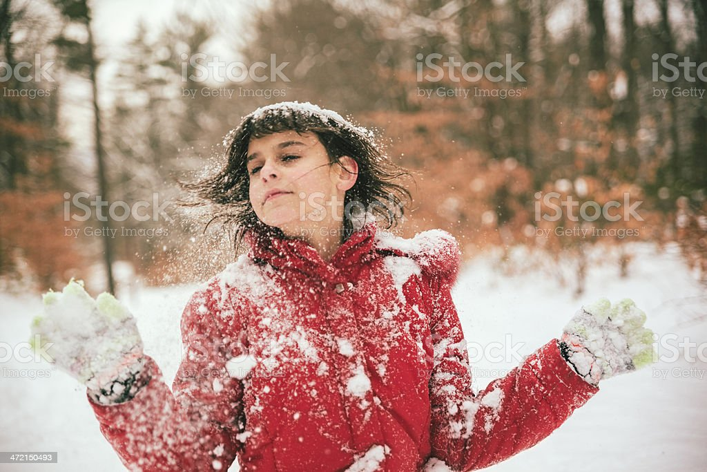 Early Teen Girl Play With Snow In The Winter Forest Royalty Free Stock Photo