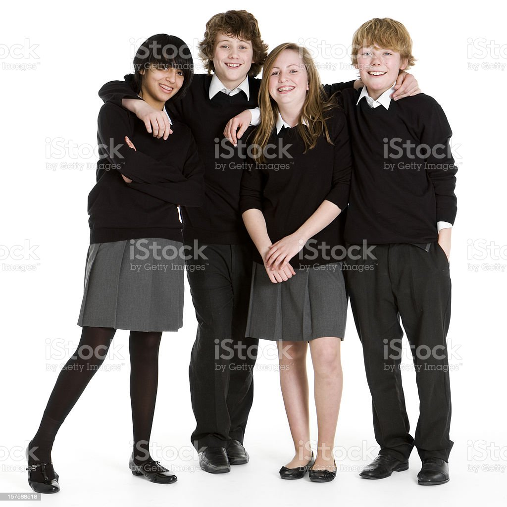 early teen students: full length portrait of uniformed school friends royalty-free stock photo