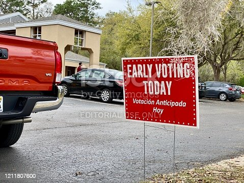 1157022917 istock photo Early voting bilingual yard sign at local precinct 1211807600