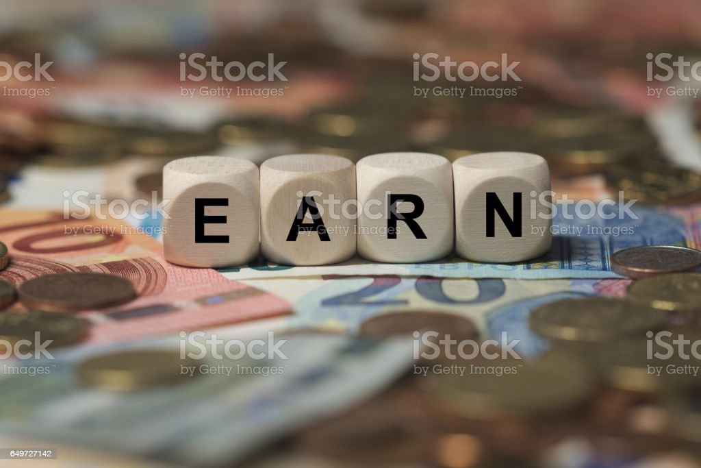 earn - cube with letters, money sector terms - sign with wooden cubes stock photo