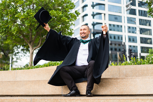 Freshly graduated Maori man in Auckland city, New Zealand.