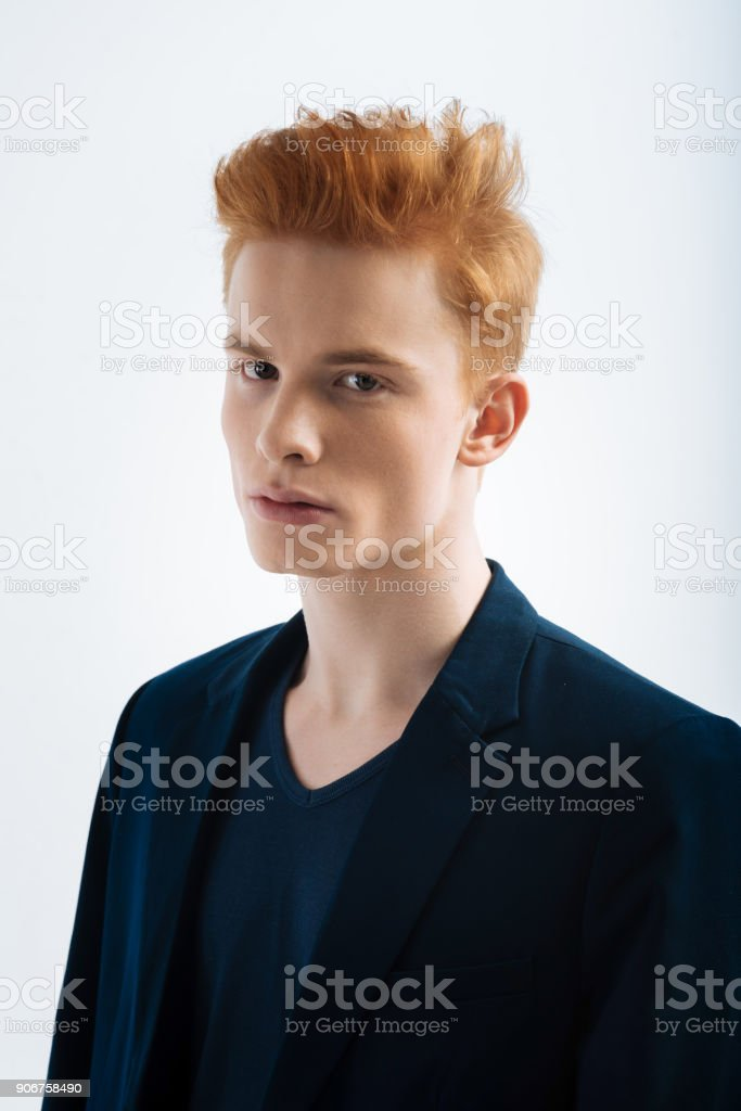Earnest young man wearing a jacket stock photo