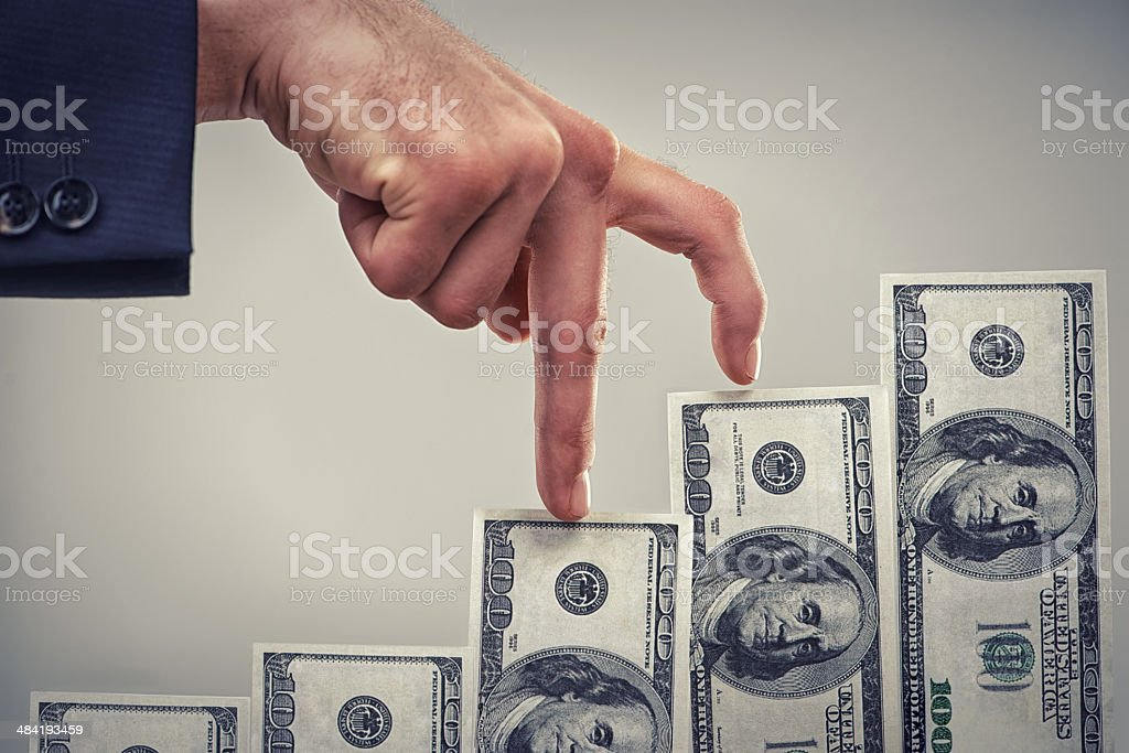 Earning wealth one step at a time stock photo