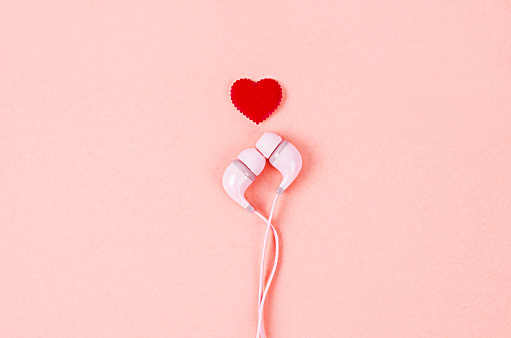 Earphone With Red Heart On Pink Background Stock Photo - Download Image Now