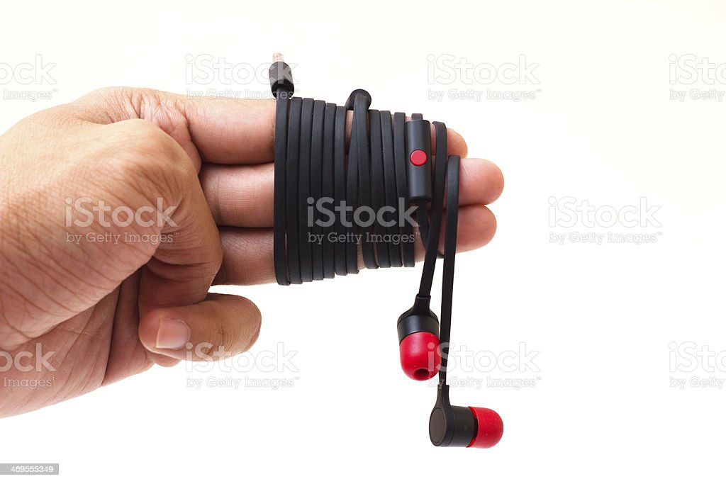 Earphones and hand royalty-free stock photo