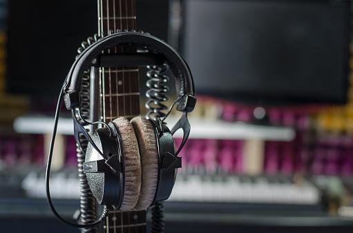 istock Earphones with neck guitar in the studio. 626946348