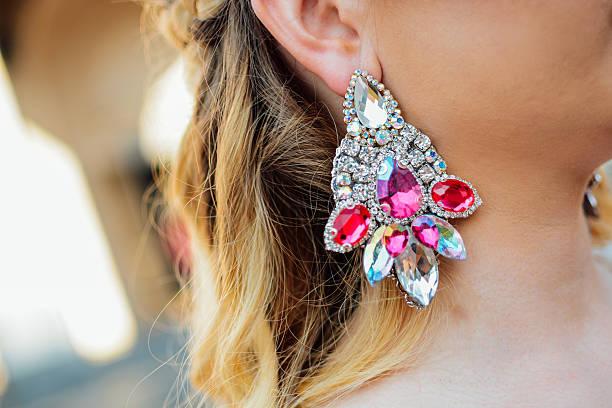 Earring on ear stock photo