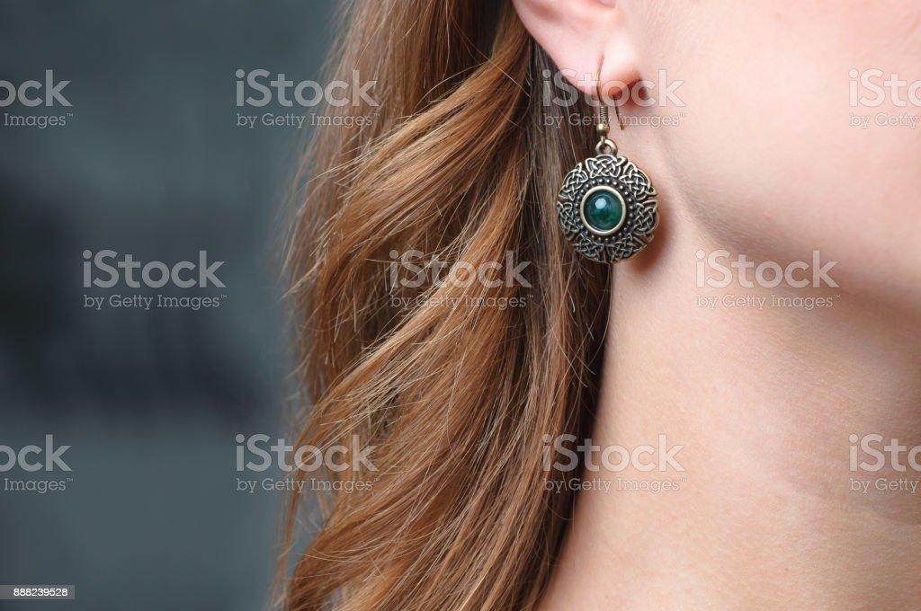 Earring on woman\'s ear