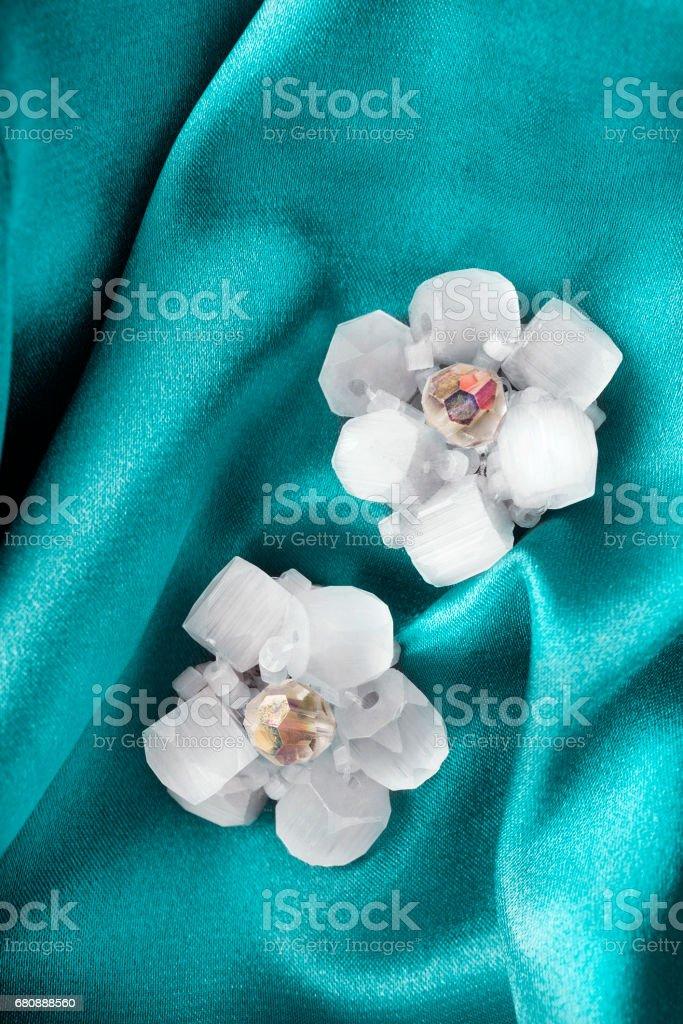Earrings on satin royalty-free stock photo