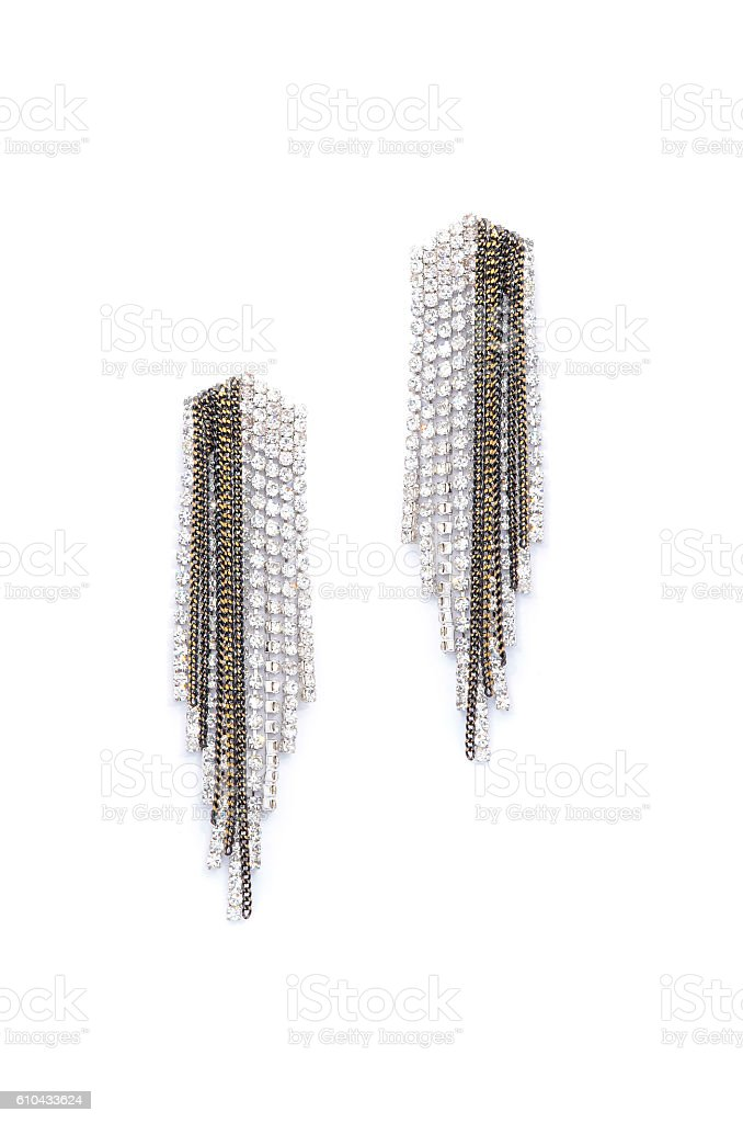 earrings with diamonds on a white background stock photo