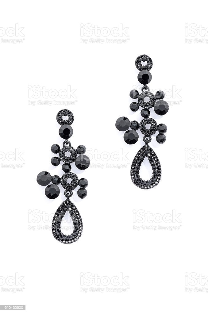 earrings with onyx on a white background stock photo