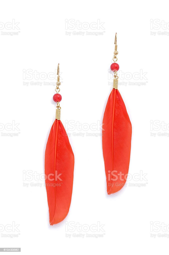 earrings with red feathers on a white background stock photo