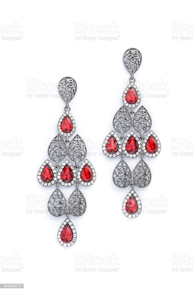 earrings with ruby on white background stock photo