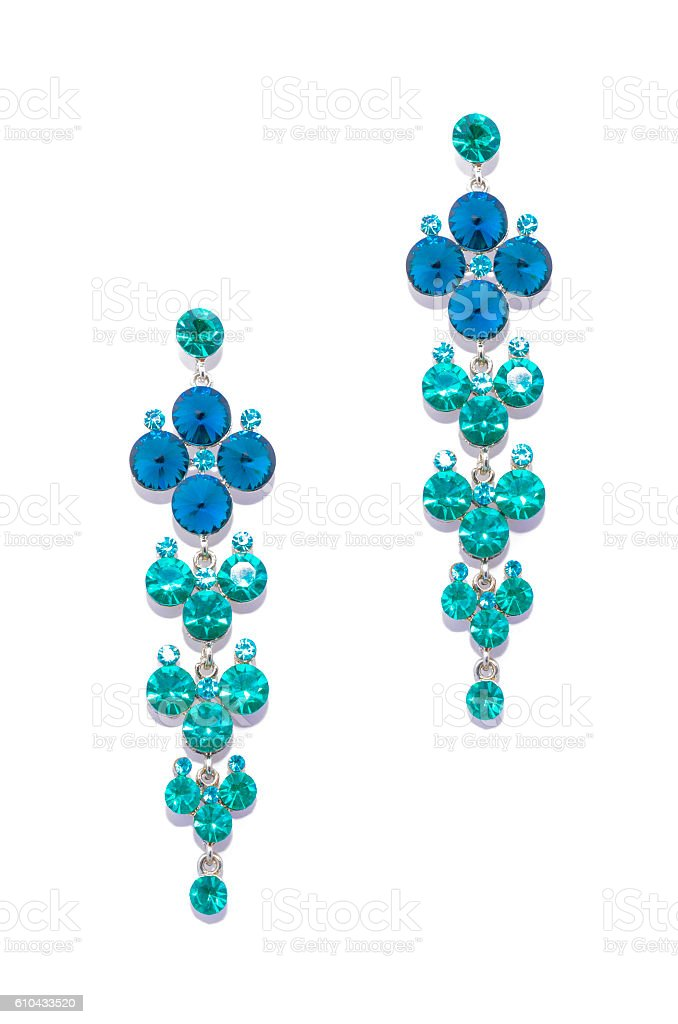 earrings with sapphire and aquamarine  on white background stock photo