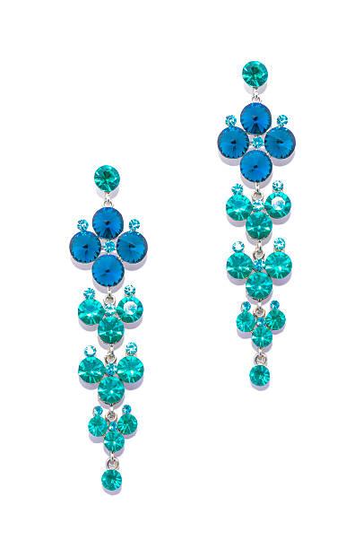 earrings with sapphire and aquamarine  on white background - ohrringe tropfen stock-fotos und bilder