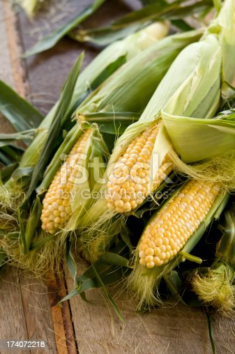 ears of corn on the table partially unhusked