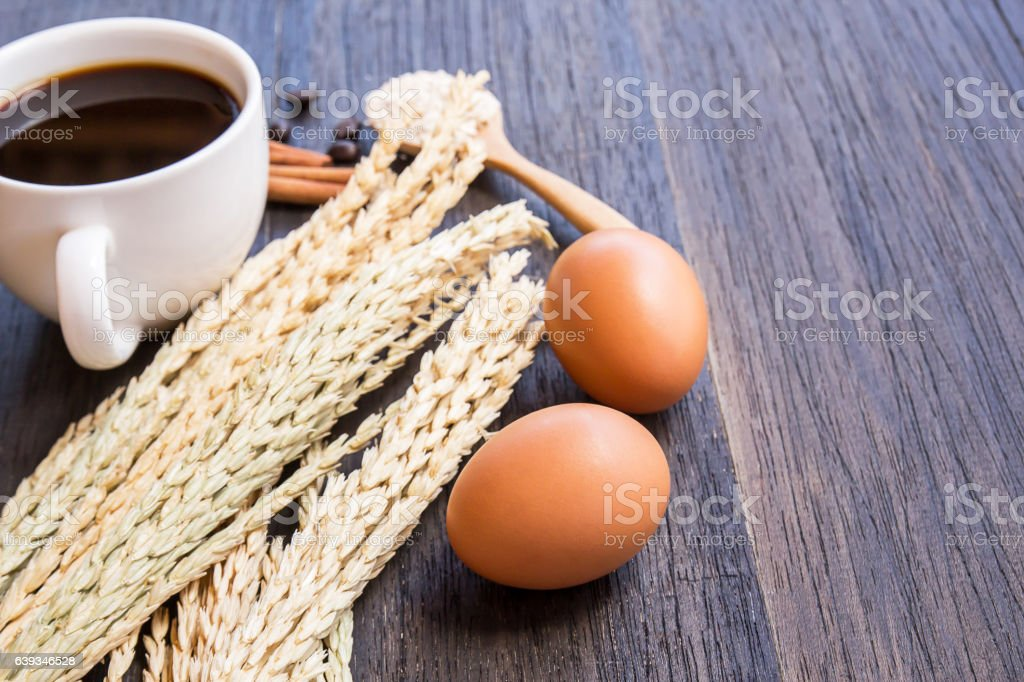 Ears of wheat and coffee with egg stock photo