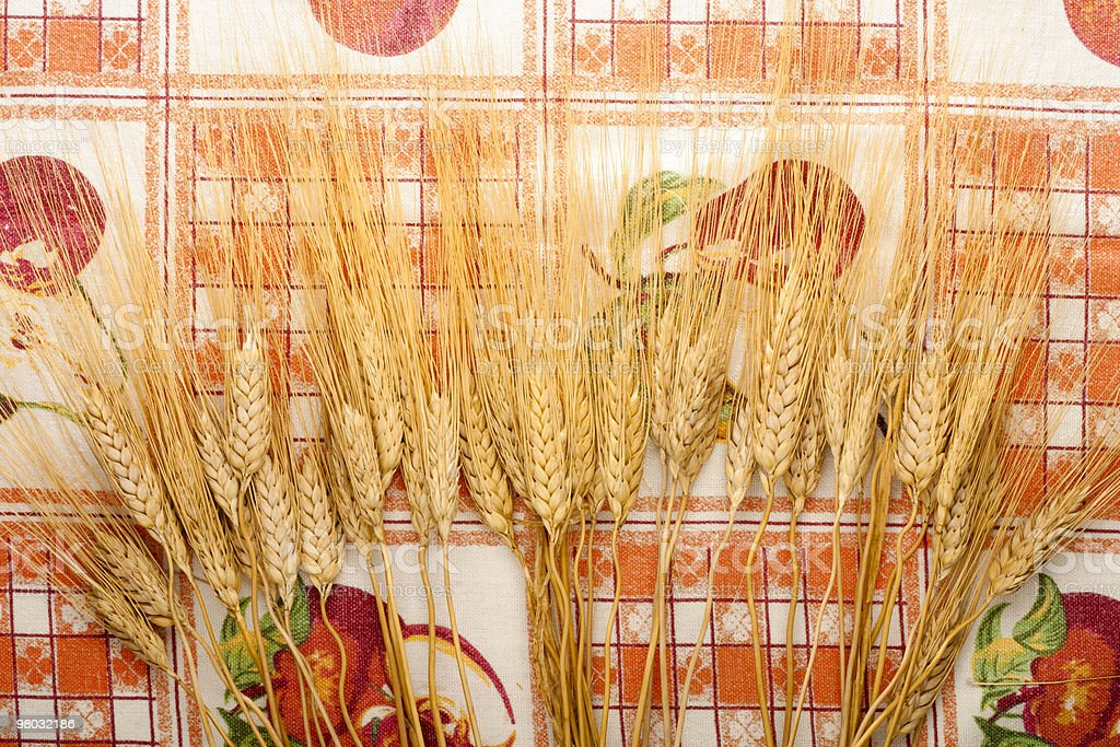 Ears of Wheat on Tablecloth royalty-free stock photo