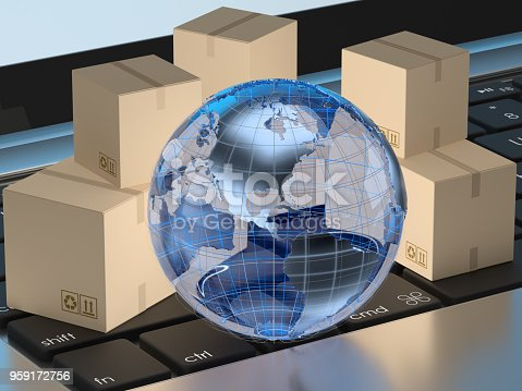 Earth and cardboard boxes on laptop keyboard