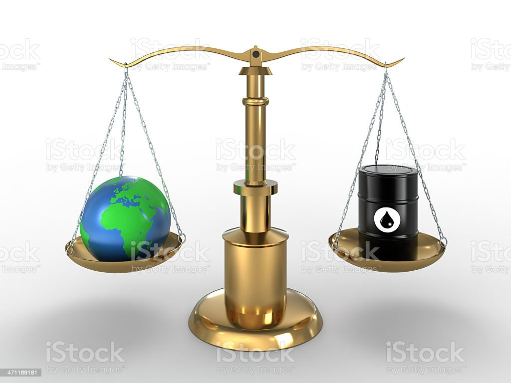 Earth and Oil, on scales (Clipping Path included) royalty-free stock photo