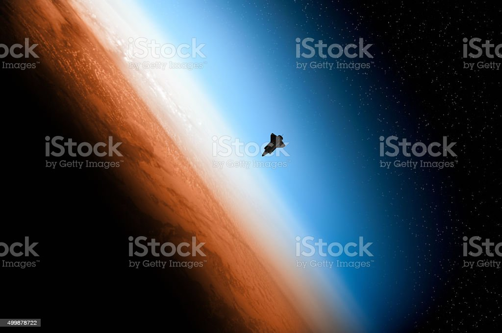 Earth and space shuttle rising stock photo