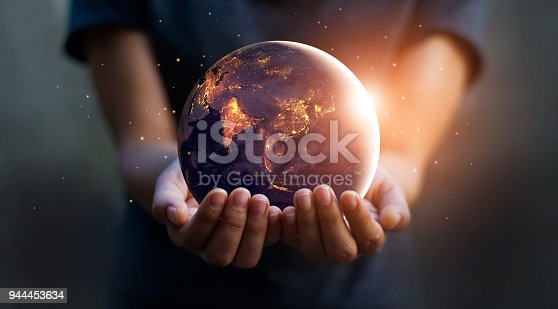 Earth at night was holding in human hands. Earth day. Energy saving concept, Elements of this image furnished by NASA   https://eoimages.gsfc.nasa.gov/images/imagerecords/79000/79790/city_lights_asia_night_8k.jpg