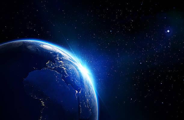 blau glänzende erde-sonnenaufgang - kennedy space center stock-fotos und bilder