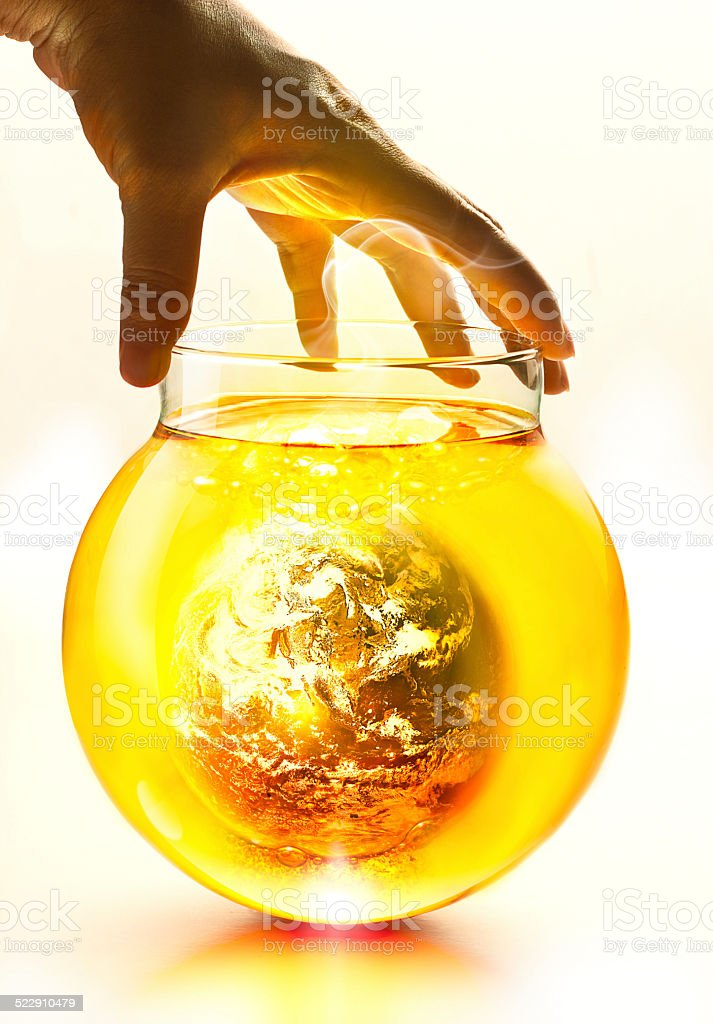 Earth burning in the bottle and yellow water boil stock photo