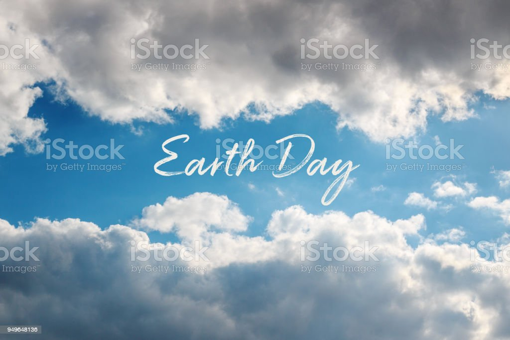 Earth Day concept card with natural frame of clouds in the sky. stock photo