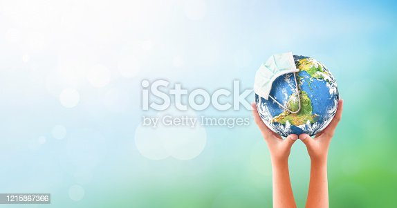 Earth Day concept: Corona virus or COVID-19 Earth wearing a mask