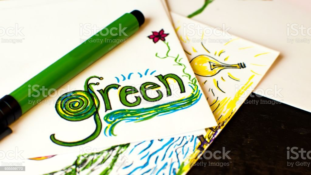 Earth day Green ideas word green written on note pad with environmental design and environmental sustainability and Green ideas. Light bulb conceptual photography background stock photo