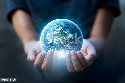 istock Earth day, Human hands holding blue earth, save earth concept. Elements of this image furnished by NASA 938918126
