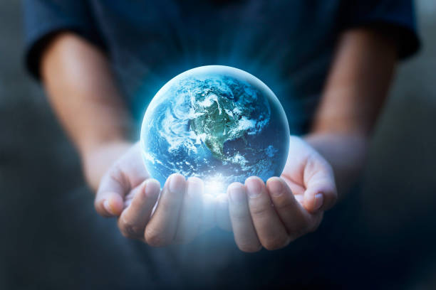 earth day, human hands holding blue earth, save earth concept. elements of this image furnished by nasa - globe zdjęcia i obrazy z banku zdjęć