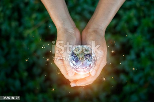 Earth day, Saving energy concept, Hand holding earth against nature on green leaf top view in the park. Save the earth and Ecological, Element of this image furnished by NASA.