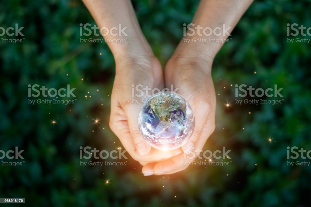 Earth day, Saving energy concept, Hand holding earth against nature on green leaf top view in the park. Save the earth and Ecological, Element of this image furnished by NASA. stock photo