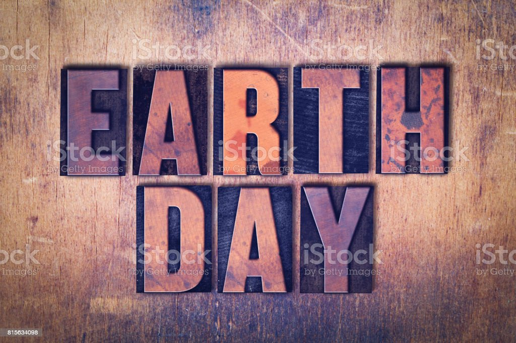 Earth Day Theme Letterpress Word on Wood Background stock photo
