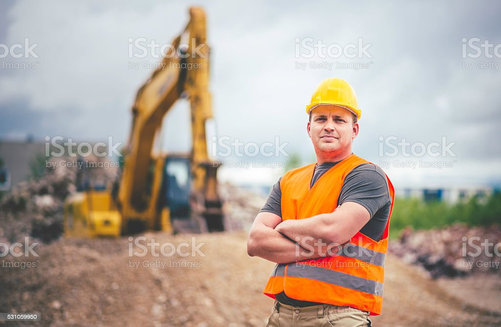 Earth Digger Driver at construction site stock photo