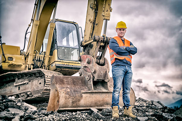 Earth Digger Driver Earth Digger Driver at construction site construction machinery stock pictures, royalty-free photos & images