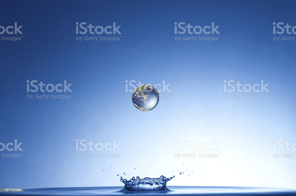 earth falling into water stock photo
