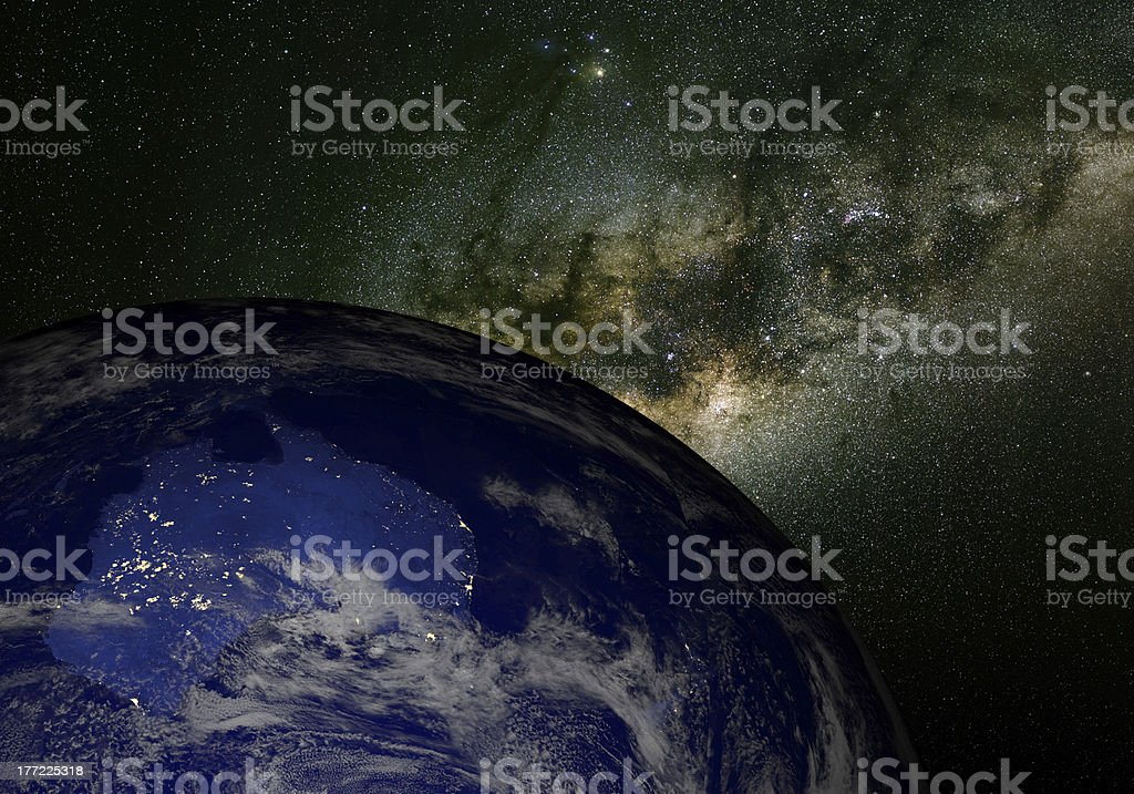 Earth from space at night and the Milky Way. Australia. stock photo