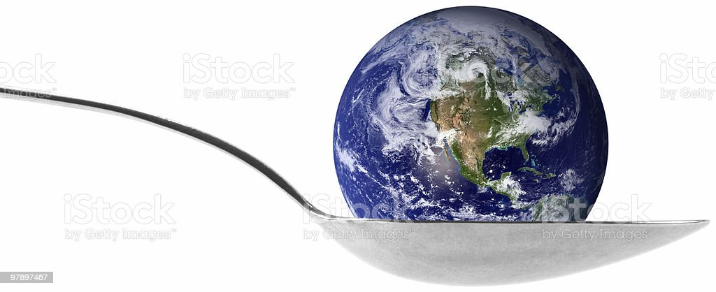 Earth globe in a spoon royalty-free stock photo