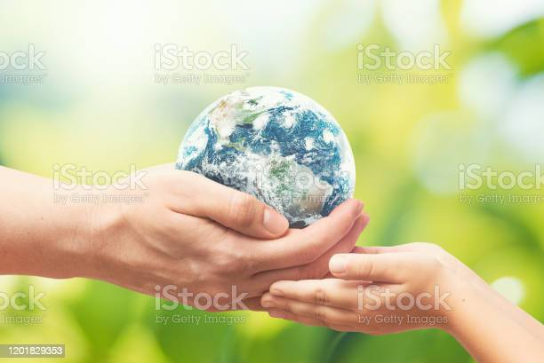 Earth globe in hands world environment day picture id1201829353?b=1&k=6&m=1201829353&s=612x612&h=a5f9r0aurjnvrjxqshhgohxcsa1zctz4gjvarduoens=