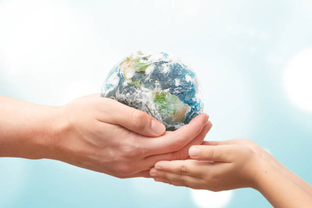 Earth globe in hands. World environment day stock photo